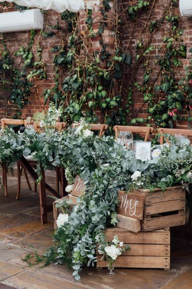 Top Table Heavy Eucalyptus Foliage with White Roses   DIY Pallet Signage   White Calligraphy   French Rustic at Northbrook Park in Surrey   Images by Charlotte Bryer-Ash