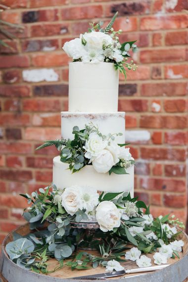 White Blooms and Green Foliage | Cake | French Rustic at Northbrook Park in Surrey | Images by Charlotte Bryer-Ash