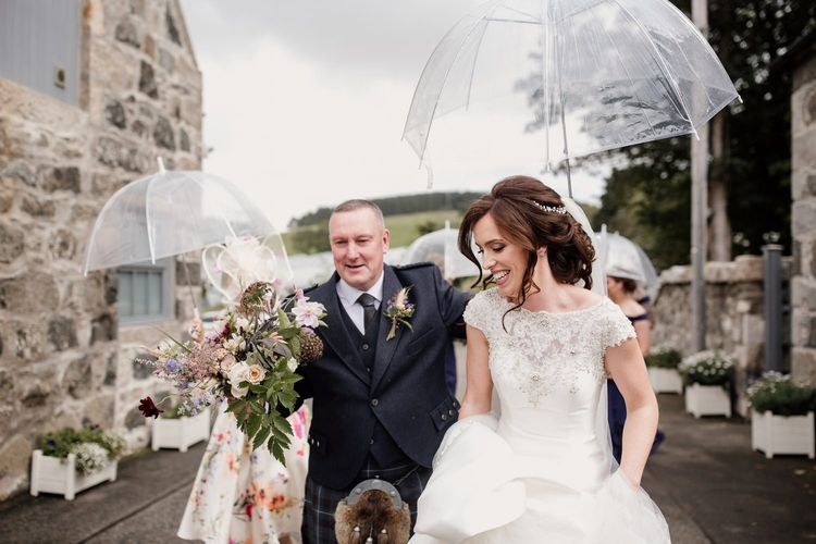 Bride in embellished top Ronald Joyce wedding dress by Aberdeen wedding photographer