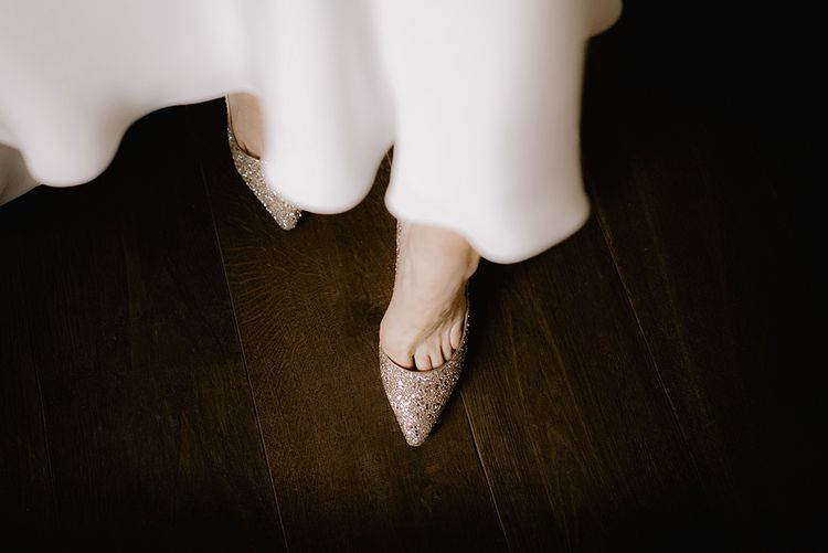 Bride in Sparkly Gold Jimmy Choo Court Shoes | Emerald Green Bridesmaid Dress for a Winter Wedding at Middleton Lodge | Georgina Harrison Photography