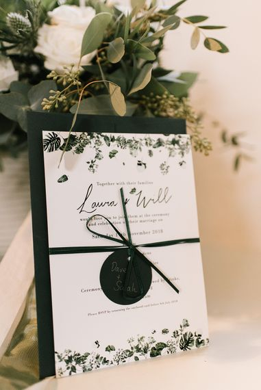 White and Green Wedding Invitation Tied with Ribbon | Emerald Green Bridesmaid Dress for a Winter Wedding at Middleton Lodge | Georgina Harrison Photography