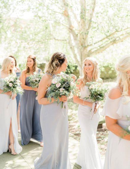 Bridesmaids in pastel Dessy dresses