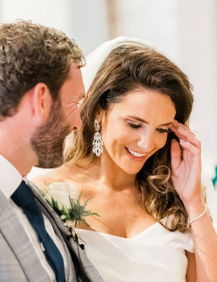 Bride wearing chandelier earrings