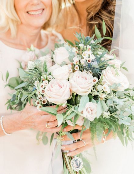 Romantic pink and green wedding bouquet with rose and eucalyptus