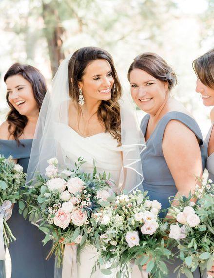 Bride in Bardot wedding dress with her bridesmaids