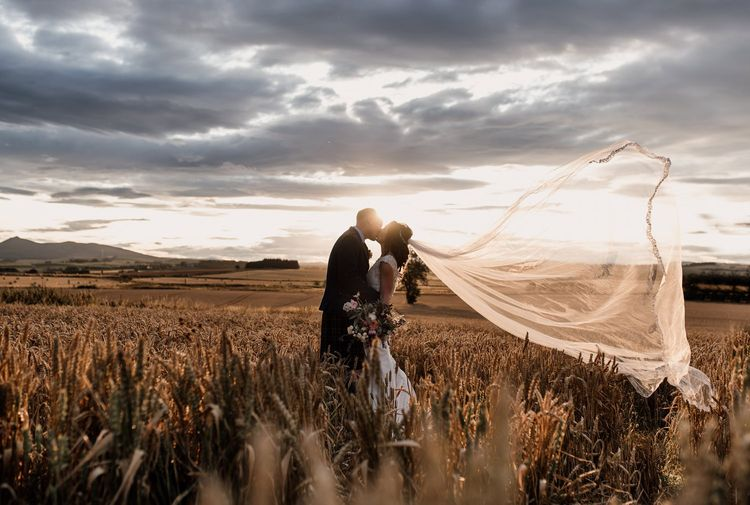 Bride & Groom in Cornfield with Billowing Veil by Aberdeen wedding photographer