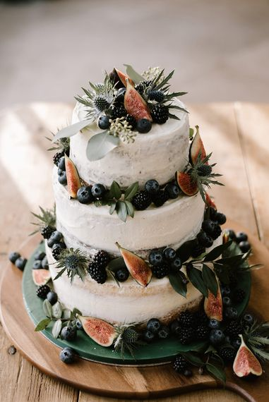 Three-Tier Semi-Naked Wedding Cake Decorated with Figs, Thistles and Berries | Emerald Green Bridesmaid Dress for a Winter Wedding at Middleton Lodge | Georgina Harrison Photography