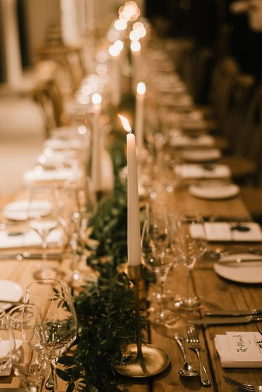 Wooden Banquet Tables | Foliage Table Runners | White Tapered Candles | Gold Candlesticks | Emerald Green Bridesmaid Dress for a Winter Wedding at Middleton Lodge | Georgina Harrison Photography