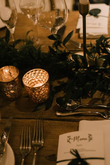 Gold Tea Light Holders | Foliage Table Runners | White Tapered Candles | Gold Candlesticks | Emerald Green Bridesmaid Dress for a Winter Wedding at Middleton Lodge | Georgina Harrison Photography