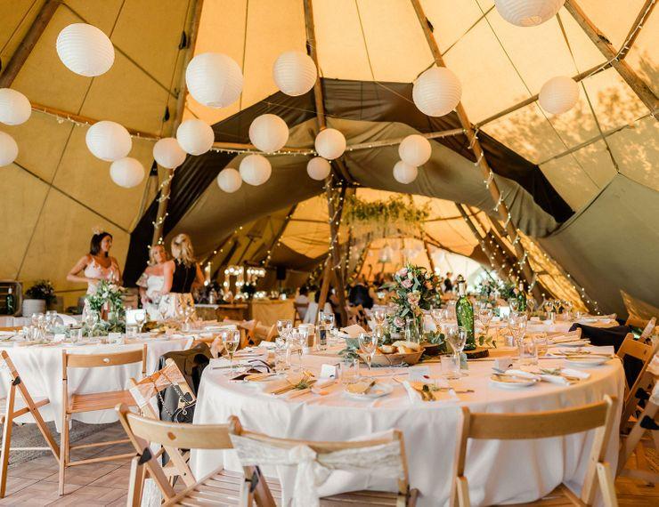 Teepee wedding reception with hanging paper lanterns wedding decor
