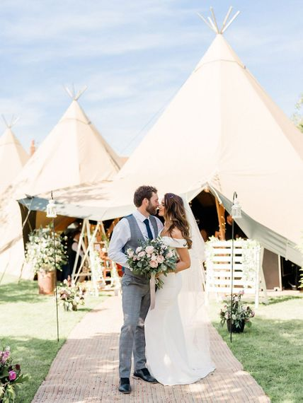 Rustic teepee wedding at the bride and grooms farm