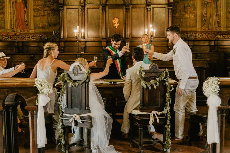 Wedding Ceremony   Bride in Lace David Fielden Wedding Dress   Groom in Beige Reiss Suit   Monastery Wedding at Monastero San Silvistro Cortona Tuscany   Joe Burford Photography