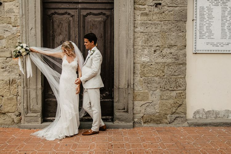 Bride in Lace David Fielden Wedding Dress   Groom in Beige Reiss Suit   Monastery Wedding at Monastero San Silvistro Cortona Tuscany   Joe Burford Photography