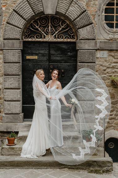 Bride in Lace David Fielden Wedding Dress & Veil   Bridesmaids in Spaghetti Strap Grey Satin Ghost Dress   Monastery Wedding at Monastero San Silvistro Cortona Tuscany   Joe Burford Photography
