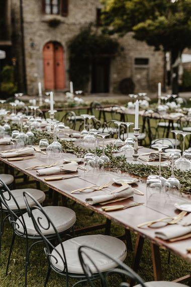 Outdoor Reception Decor   Tablescape with Candles & Greenery Table Runner   Monastery Wedding at Monastero San Silvistro Cortona Tuscany   Joe Burford Photography