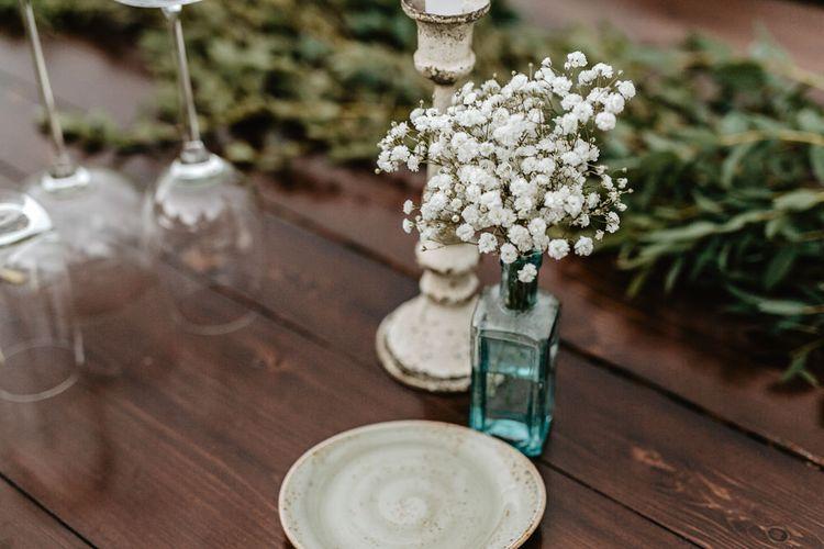 Outdoor Reception Decor   Gypsophila in a Jar   Monastery Wedding at Monastero San Silvistro Cortona Tuscany   Joe Burford Photography