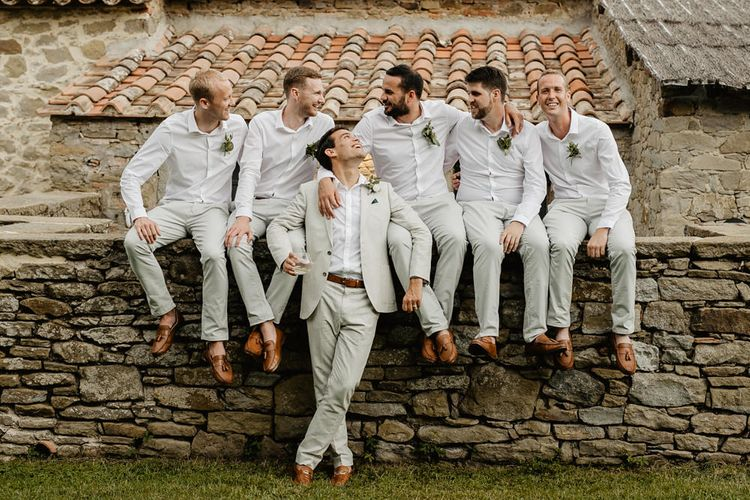 Groom in Beige Reiss Suit   Groomsmen in Chino's & Blazers   Monastery Wedding at Monastero San Silvistro Cortona Tuscany   Joe Burford Photography