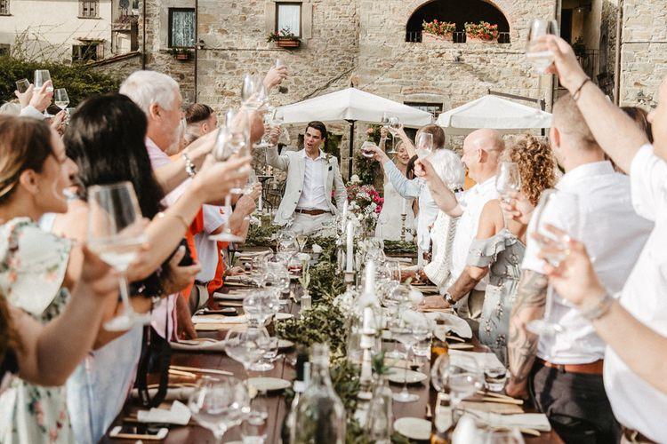 Outdoor Wedding Reception   Tablescape with Candles & Greenery Table Runner   Monastery Wedding at Monastero San Silvistro Cortona Tuscany   Joe Burford Photography