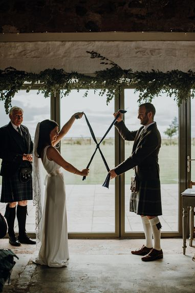 Traditional Tying the Knot Ceremony   Styled, Humanist Wedding at The Cow Shed, Crail, Scotland   Foliage & Potted Plants decor with Cement and Glass Accents   Dress is Charlie Brear   Photography by Claire Fleck