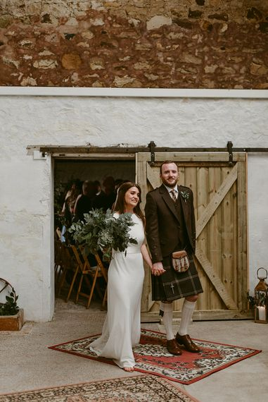 Styled, Humanist Wedding at The Cow Shed, Crail, Scotland   Foliage & Potted Plants decor with Cement and Glass Accents   Dress is Charlie Brear   Photography by Claire Fleck