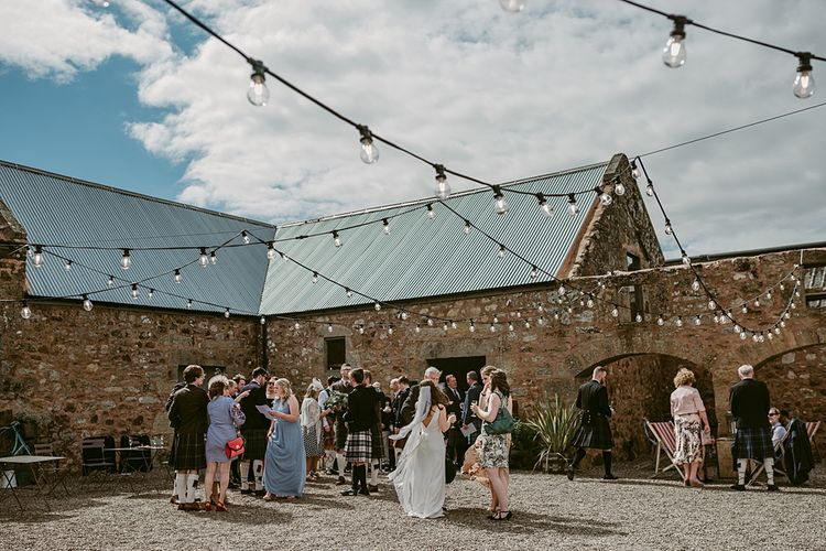 Humanist Wedding at The Cow Shed, Crail, Scotland   Foliage & Potted Plants decor with Cement and Glass Accents   Dress is Charlie Brear   Photography by Claire Fleck