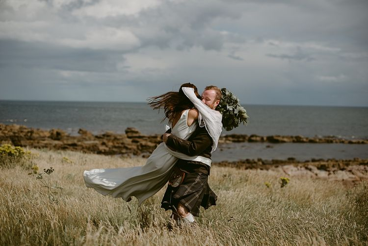Couple Shots   Styled, Humanist Wedding at The Cow Shed, Crail, Scotland   Foliage & Potted Plants decor with Cement and Glass Accents   Dress is Charlie Brear   Photography by Claire Fleck