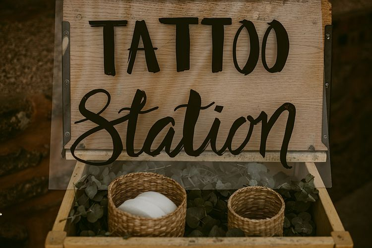Tattoo Station   Styled, Humanist Wedding at The Cow Shed, Crail, Scotland   Foliage & Potted Plants decor with Cement and Glass Accents   Dress is Charlie Brear   Photography by Claire Fleck