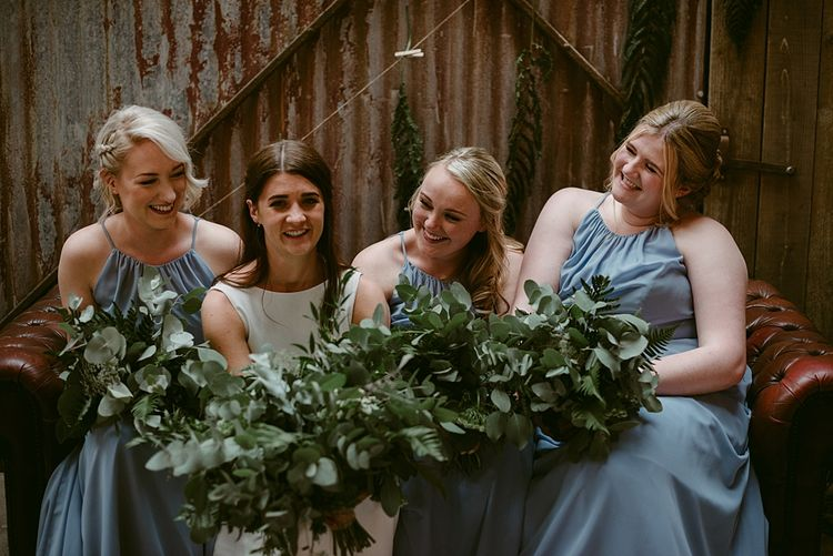 Bouquets by The Flower House   Styled, Humanist Wedding at The Cow Shed, Crail, Scotland   Foliage & Potted Plants decor with Cement and Glass Accents   Dress is Charlie Brear   Photography by Claire Fleck