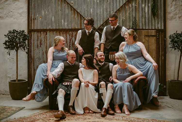 Group Shots   Styled, Humanist Wedding at The Cow Shed, Crail, Scotland   Foliage & Potted Plants decor with Cement and Glass Accents   Dress is Charlie Brear   Photography by Claire Fleck