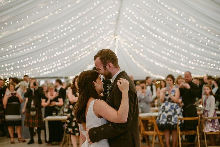 Lighting by Wedding Lighting and Mobile Hire   Styled, Humanist Wedding at The Cow Shed, Crail, Scotland   Foliage & Potted Plants decor with Cement and Glass Accents   Dress is Charlie Brear   Photography by Claire Fleck