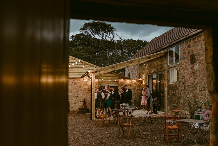 Wedding Lighting and Mobile Hire   Styled, Humanist Wedding at The Cow Shed, Crail, Scotland   Foliage & Potted Plants decor with Cement and Glass Accents   Dress is Charlie Brear   Photography by Claire Fleck