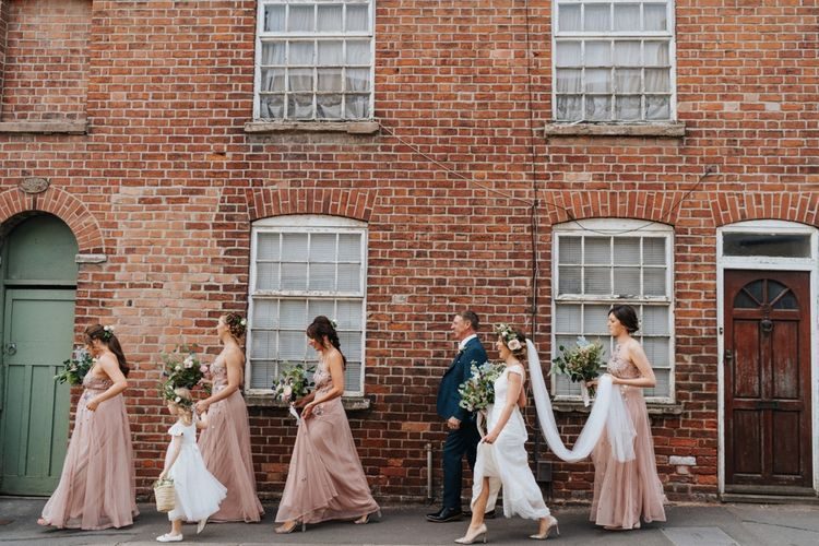 Bridal party make their way to ceremony