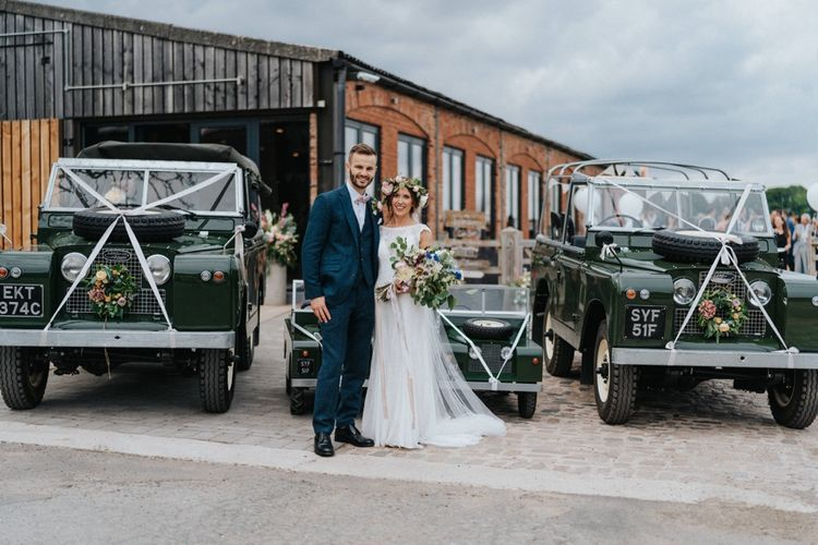 Bride and groom with wedding transport and DIY wedding decor