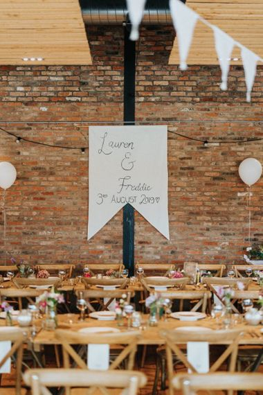 DIY wedding decor with personalised banner and wedding balloons
