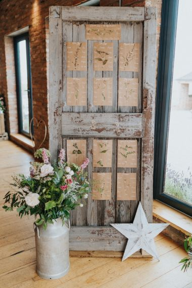DIY wedding decor with rustic seating chart and flower decor