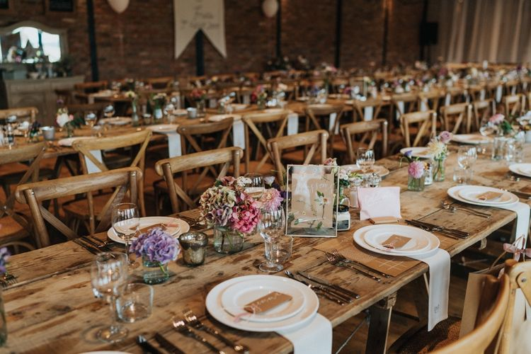 Beautiful rustic wedding setting with pastel flowers