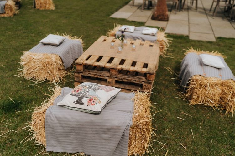 Outdoor seating area at rustic barn wedding