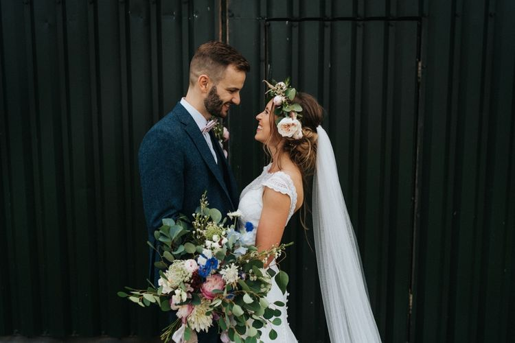 Bride wears flower crown with large bouquet