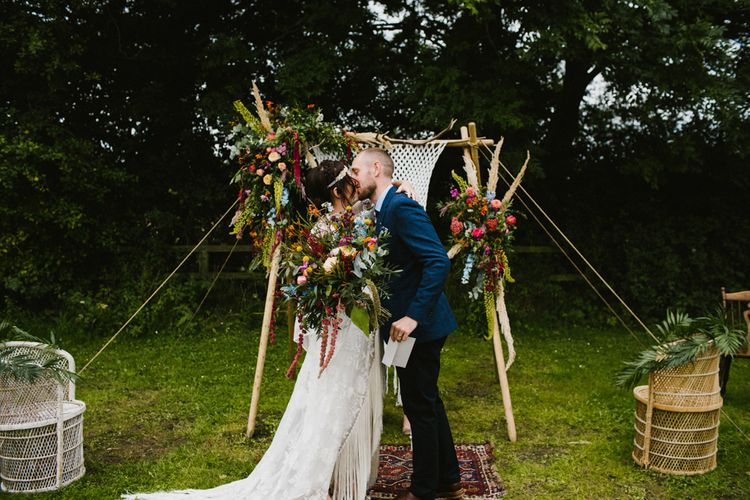 Floral  & Macrame Arch For Wedding Ceremony // The Fire Pit Camp Norfolk Wedding With Bride In Cleo Dress By Rue De Seine Dress And Images From Honey And The Moon Photography