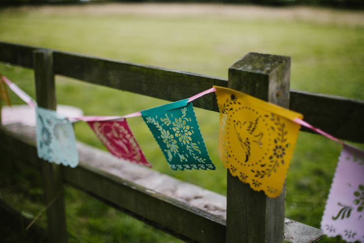 Colourful Paper Bunting For Wedding // The Fire Pit Camp Norfolk Wedding With Bride In Cleo Dress By Rue De Seine Dress And Images From Honey And The Moon Photography
