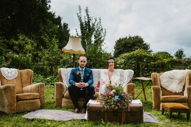 Boho Outdoor Seating Area For Wedding // The Fire Pit Camp Norfolk Wedding With Bride In Cleo Dress By Rue De Seine Dress And Images From Honey And The Moon Photography