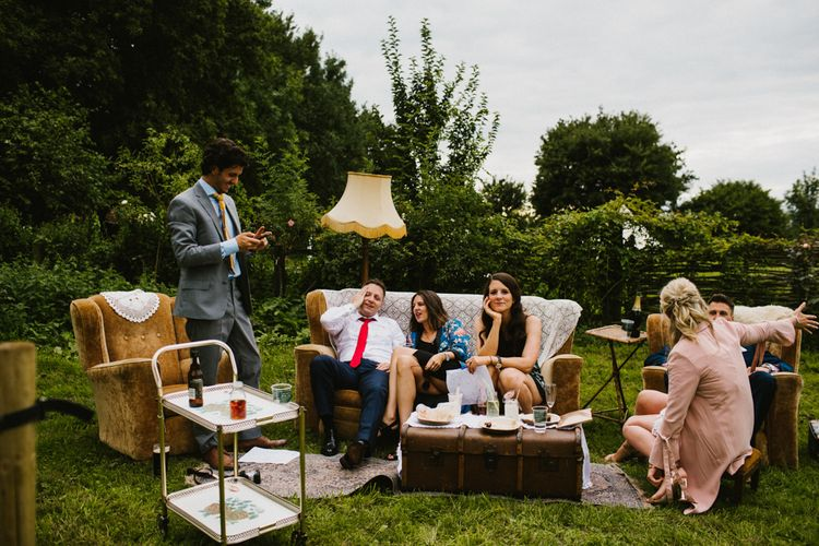 Boho Outdoor Seating Area For Wedding Guests // The Fire Pit Camp Norfolk Wedding With Bride In Cleo Dress By Rue De Seine Dress And Images From Honey And The Moon Photography