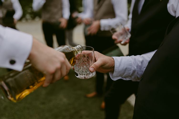 Whiskey Glass | Outdoor Boho Wedding at Chateau le Tour, France | Adam and Grace Photography | Head and Heart Films