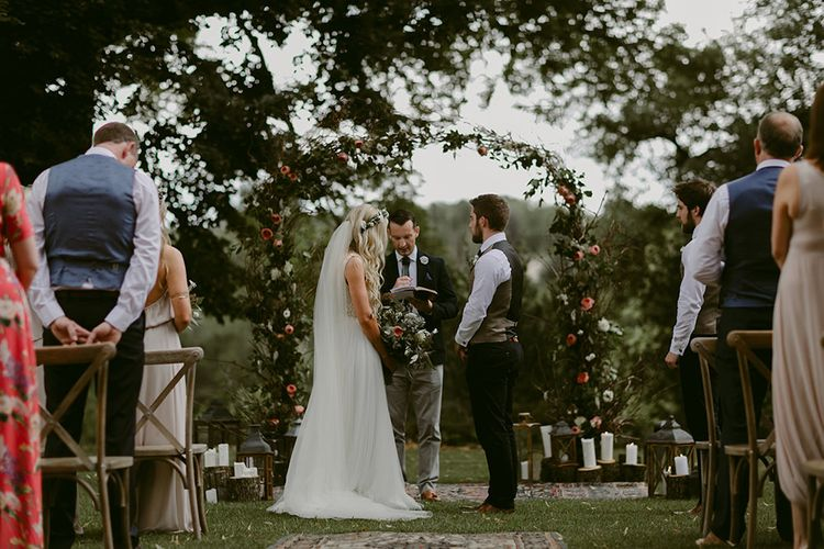 Wedding Ceremony | Floral Arch | Outdoor Boho Wedding at Chateau le Tour, France | Adam and Grace Photography | Head and Heart Films