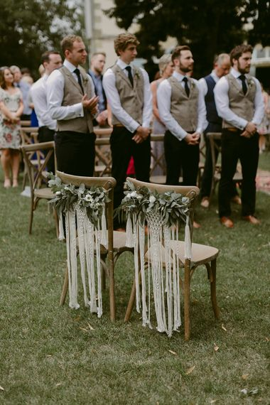 Macrame Chair Backs & Foliage Garlands | Outdoor Wedding Ceremony | Outdoor Boho Wedding at Chateau le Tour, France | Adam and Grace Photography | Head and Heart Films