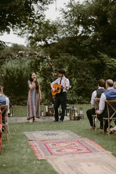 Wedding Ceremony | Persian Rug & Floral Arch Wedding Decor | Outdoor Boho Wedding at Chateau le Tour, France | Adam and Grace Photography | Head and Heart Films
