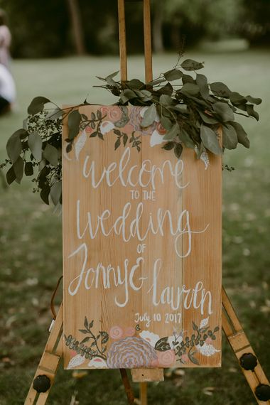 Wooden Wedding Welcome Sign with Greenery Decor | Outdoor Boho Wedding at Chateau le Tour, France | Adam and Grace Photography | Head and Heart Films