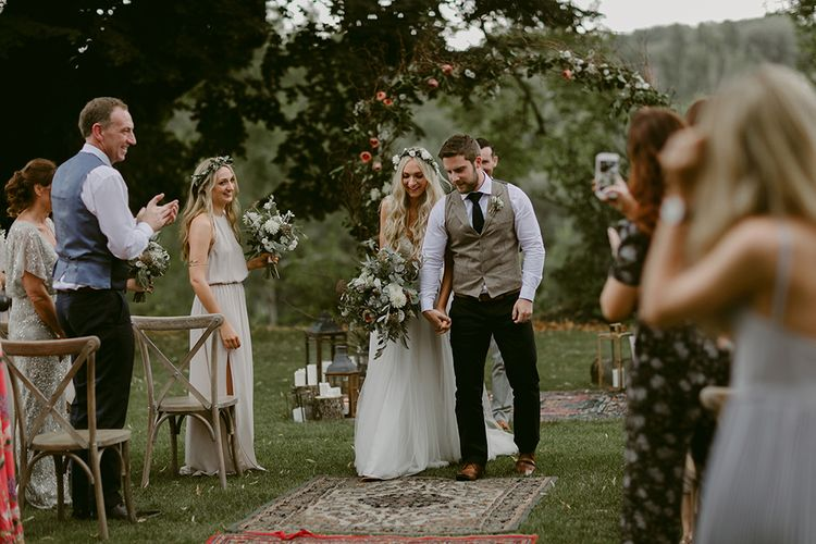 Outdoor Wedding Ceremony | Bride in Daalarna Gown | Groom in Waistcoat | Persian Rug, & Floral Arch Aisle & Altar Wedding Decor | Outdoor Boho Wedding at Chateau le Tour, France | Adam and Grace Photography | Head and Heart Films