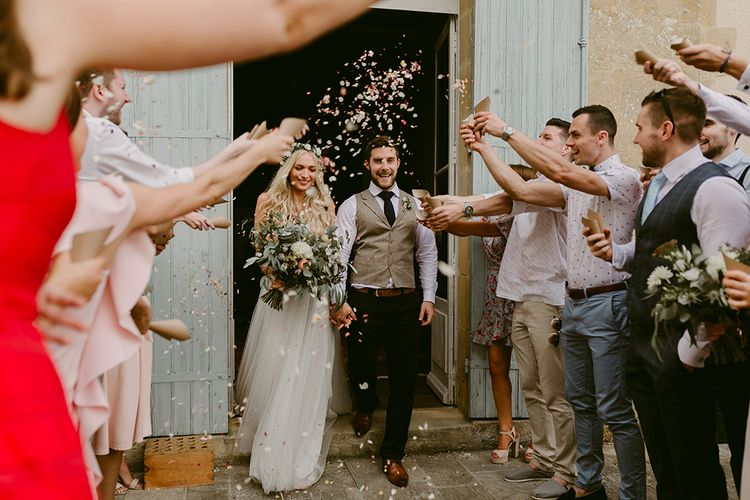 Confetti Exit | Bride in Daalarna Bridal Gown | Groom in Waistcoat | Outdoor Boho Wedding at Chateau le Tour, France | Adam and Grace Photography | Head and Heart Films