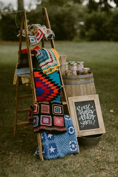 Smore's and Blankets | Trestle Tablescape | Festoon Lit Outdoor Boho Wedding at Chateau le Tour, France | Adam and Grace Photography | Head and Heart Films